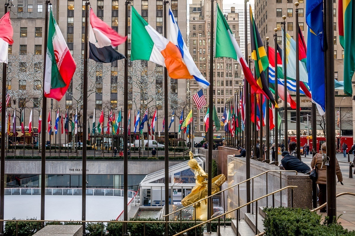Rockefeller Center Plaza surrounded by flags in New York