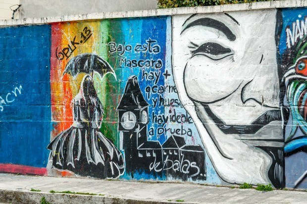An anonymous mask as street art in Cotacachi, Ecuador.