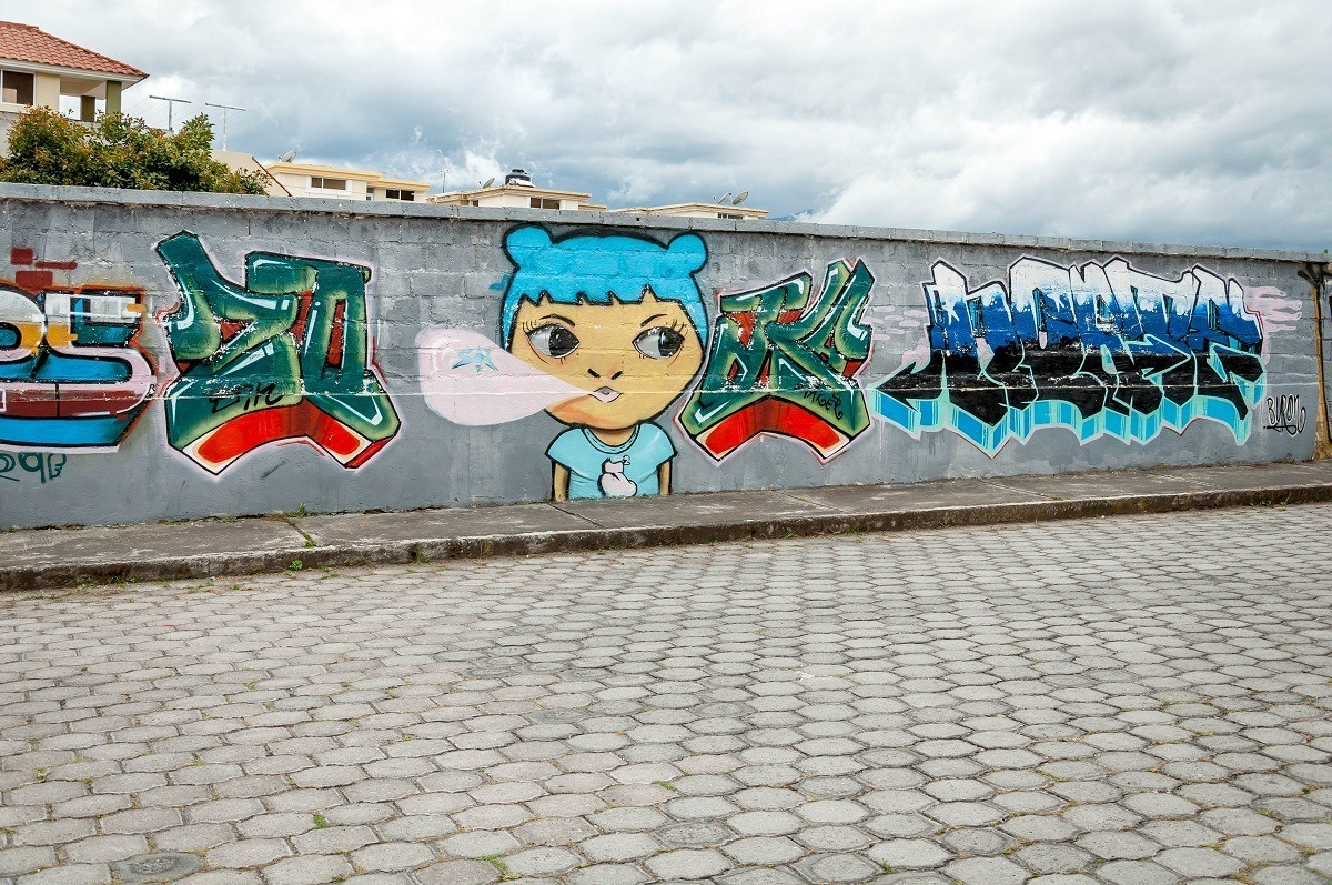 Graffiti mural of girl in Cotacachi