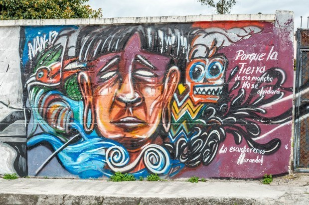 An indigenous street art mural in Cotacachi, Ecuador