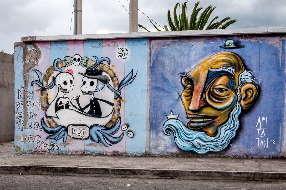 Murals in Otavalo of old man and dancing skeletons
