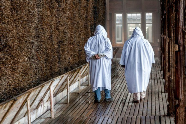 White hooded robes protect visitor's clothes as they walk along the evaporation walls at the Keltenbad spa in Bad Salzungen, Germany.