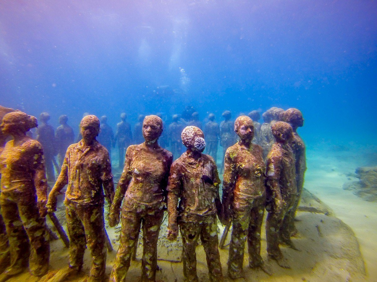 "Jason deCaires Taylor's ""The Vicissitudes "" at the Grenada Underwater Sculpture Park in Molinere Bay."