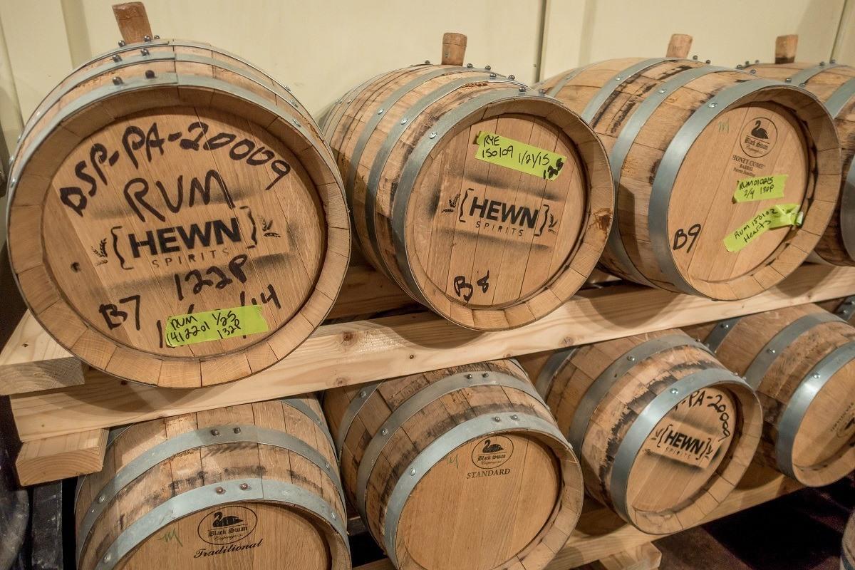 Aging barrels at Hewn Spirits
