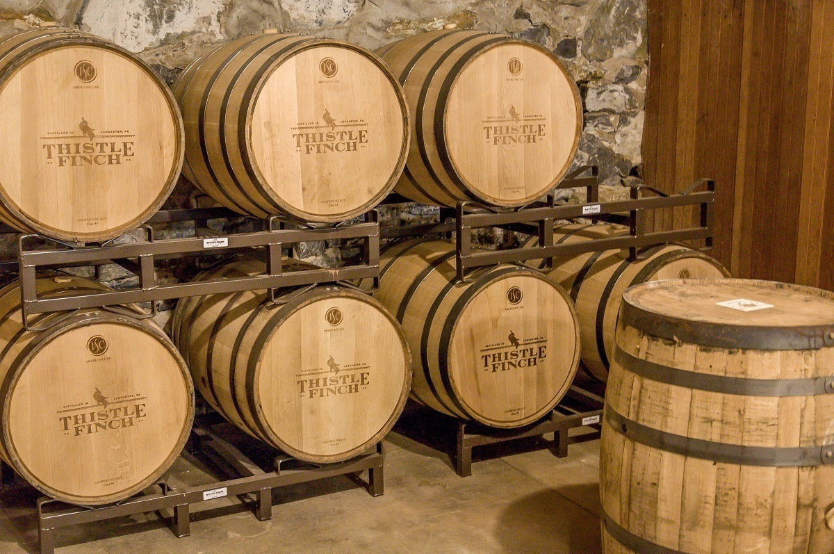 Aging barrels at Thistle Finch Distillery in Lancaster - one of the top Pennsylvania distilleries.