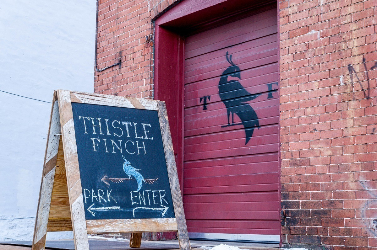 The sign for Thistle Finch Distillery in Lancaster, Pennsylvania.