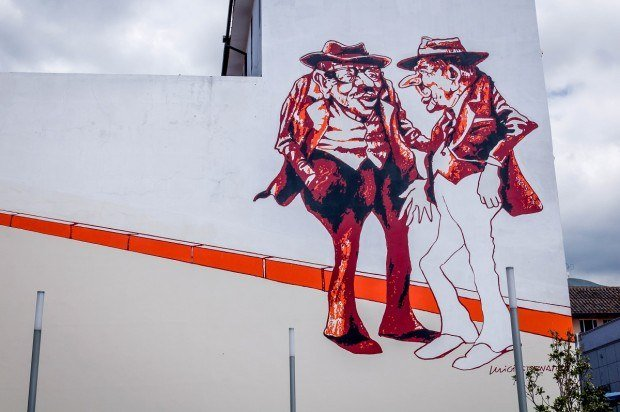 Two Old Men - a massive multi-story street art mural in downtown Quito, Ecuador by Luigi Stornaiolo.