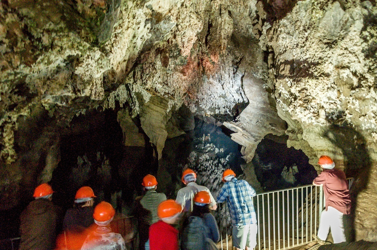 A group exploring inside the Sterkfontein Cave while taking one of the Cradle of Humankind tours.