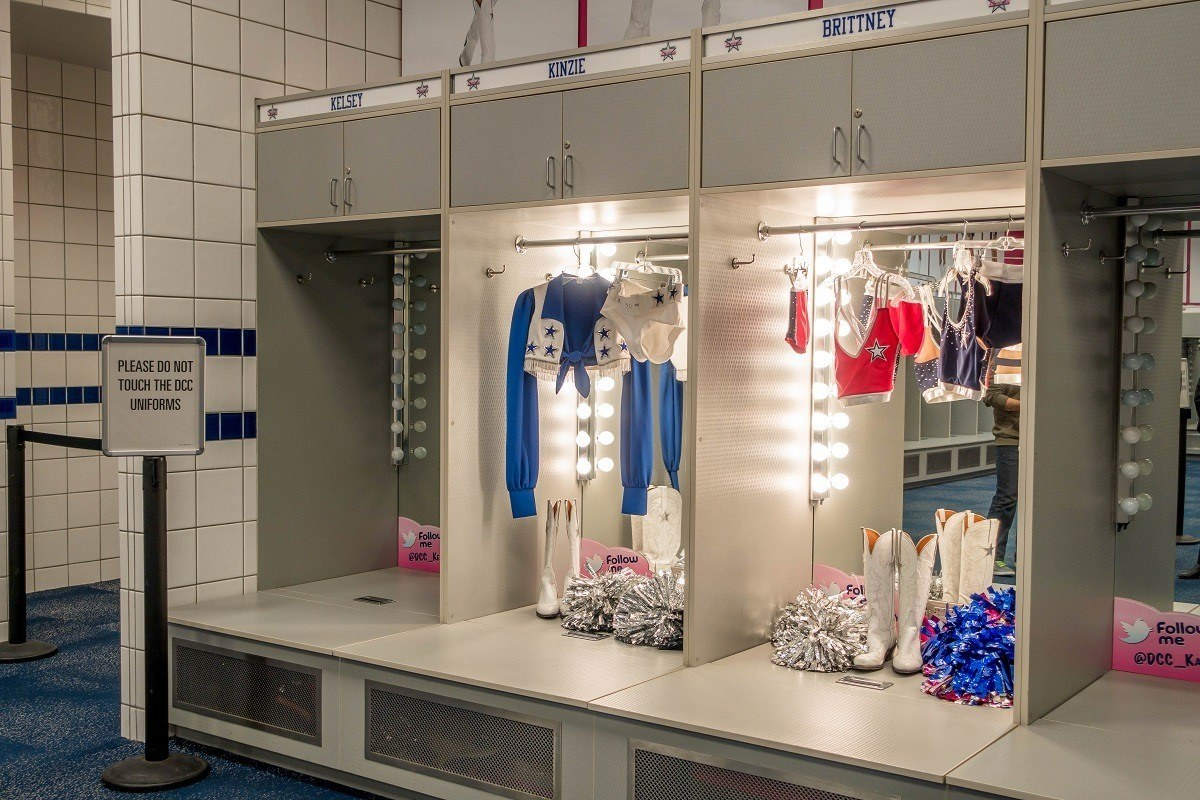 Uniforms on display in the Dallas Cowboys cheerleaders' locker room while touring AT&T Stadium