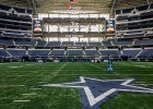 Walking on the field during a Dallas Cowboys stadium tour in Arlington TX