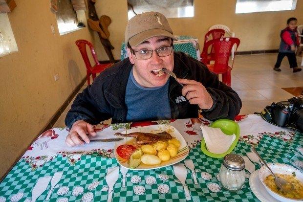 Lance eating cuy (guinea pig), a popular Ecuadorian food