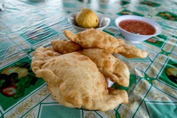 The massive Empanada de Viento (or air empanadas) were one of our favorite Ecuador foods. They are filled with a tiny bit of gooey fried cheese and taste great with a little sugar or aji hot sauce.