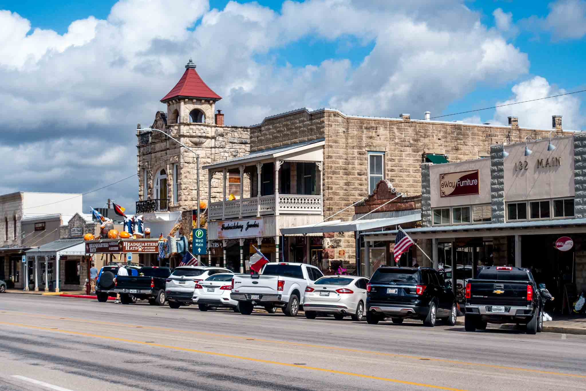 Buildings and cars on Main Street in Fredericksburg TX