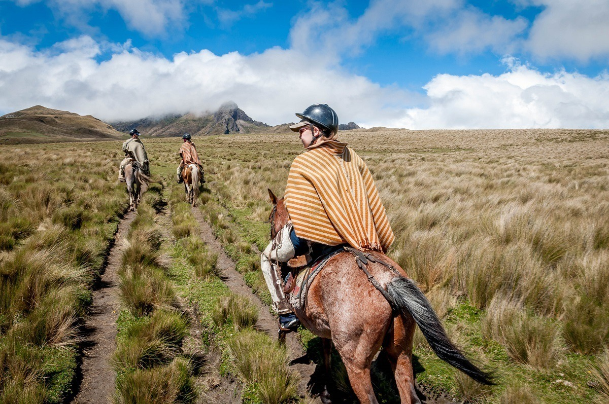 Laura and our guides horseback riding in the Avenue of the Volcanoes up the side of Rumiñahui.