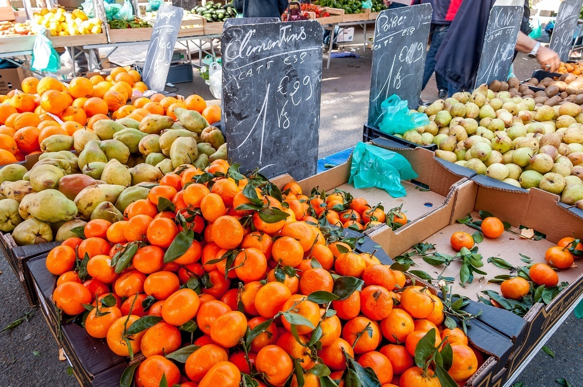 Oranges and pears for sale at the outdoor market in Arles, France