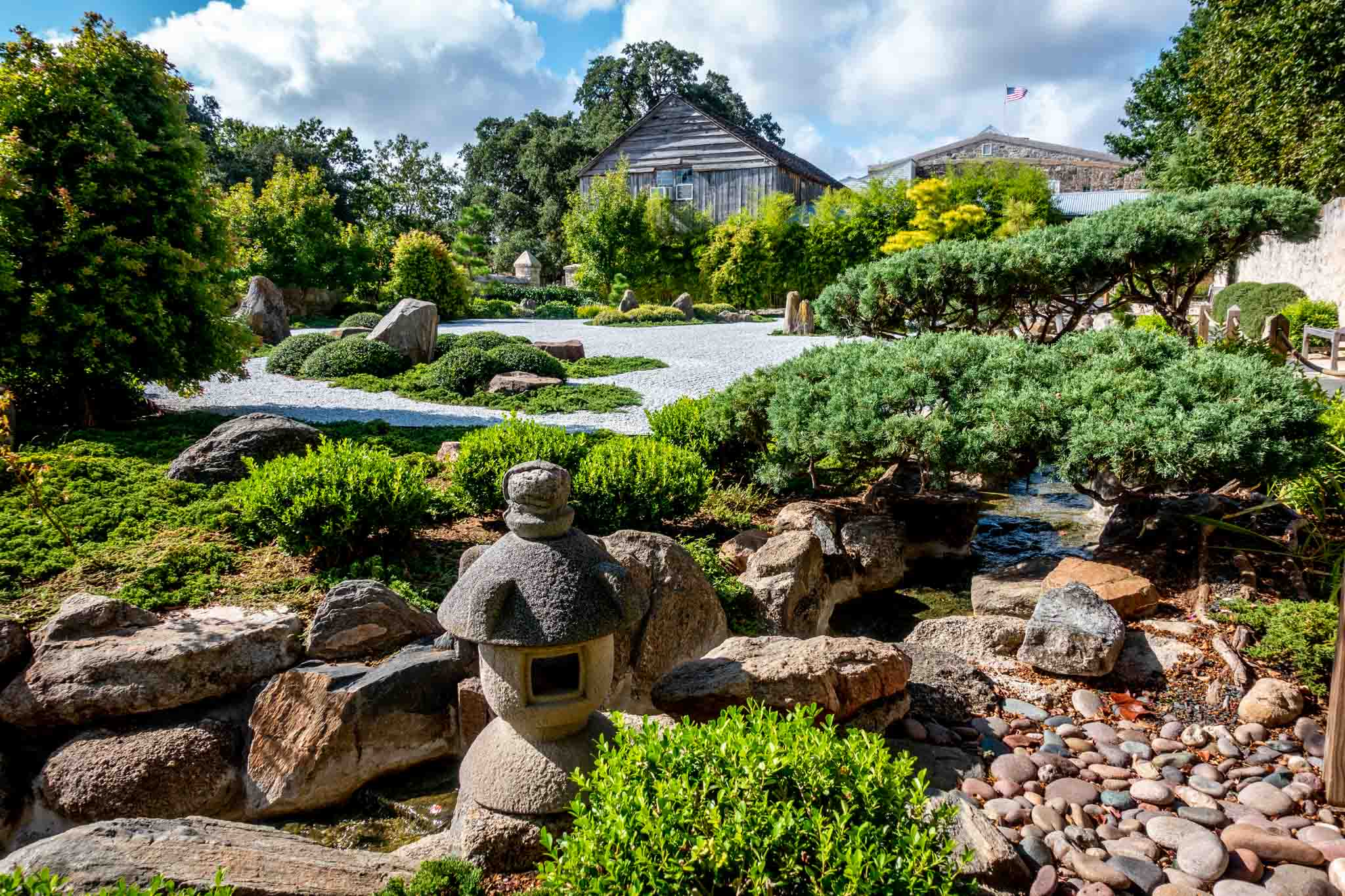 Plants and decorations in the Japanese Garden of Peace in Fredericksburg, Texas