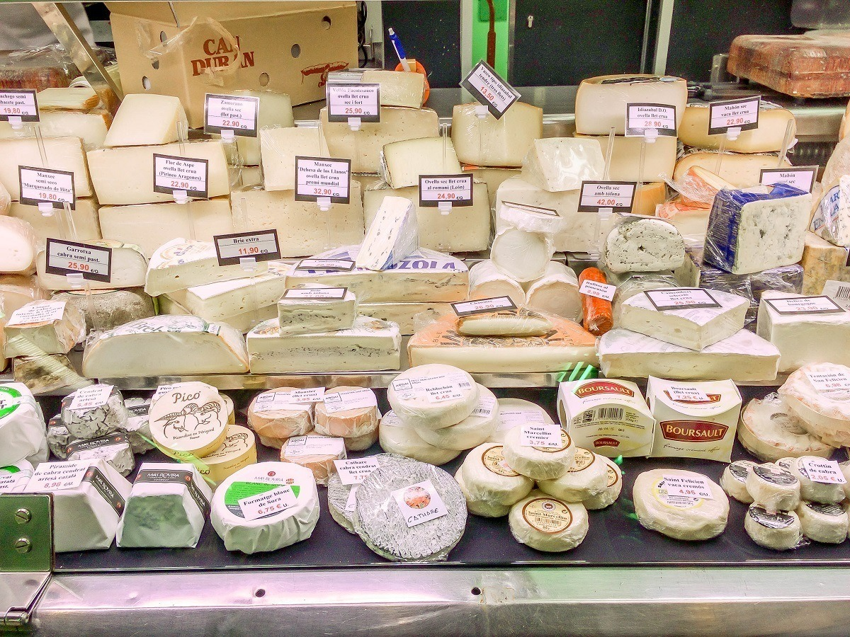 Catalan cuisine features a wide variety of cheeses, such as this selection at the Mercat de l'Abaceria Central in Barcelona's Gracia neighborhood.