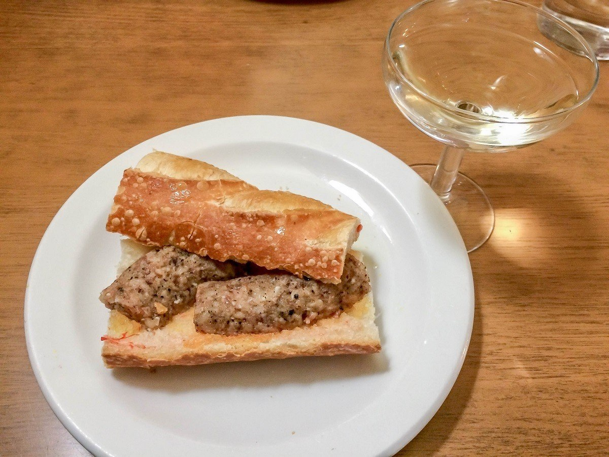 "A grilled botifarra (sausage) sandwich with a glass of cava can be a ""second breakfast"" in Catalonia cuisine."