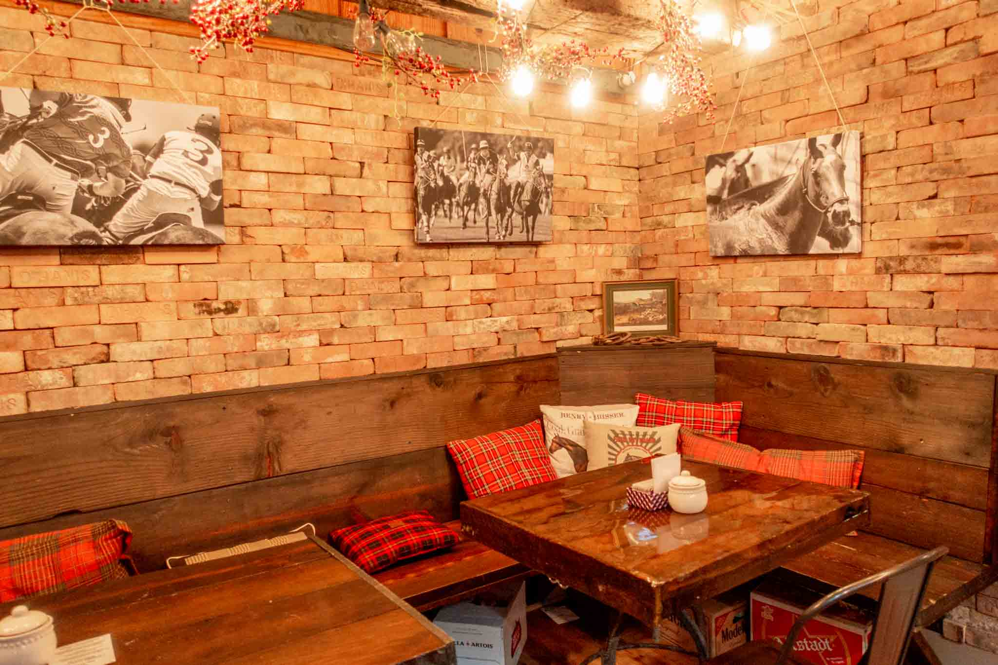 Cozy, equestrian-themed interior of The Stable Bar