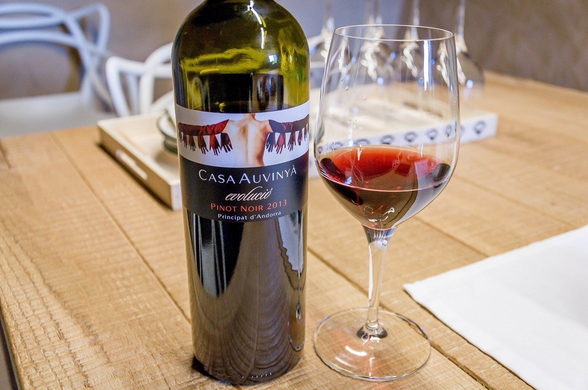 Bottle and glass of wine at Celler Casa Auvinya in Andorra