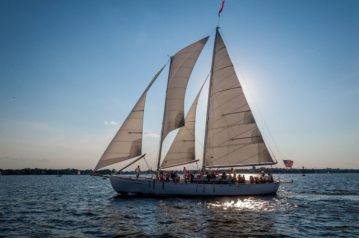 Schooner with many passengers sailing on water