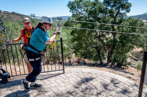 Getting a running start at the top of the zip line at Margarita Adventures near Paso Robles, California.