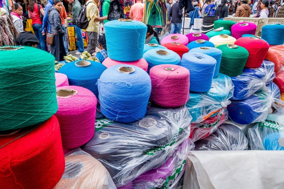 Spools of yarn at the Otavalo Saturday market in Ecuador.  The market is still frequented by locals who shop for their supplies.