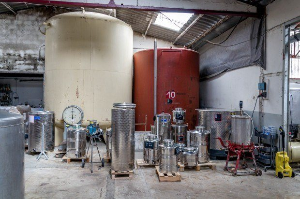 Manguin Distillery in Avignon, France, is known for its Poire Williams Eau de Vie and liqueurs. Many of the products are kept in these holding tanks before bottling.