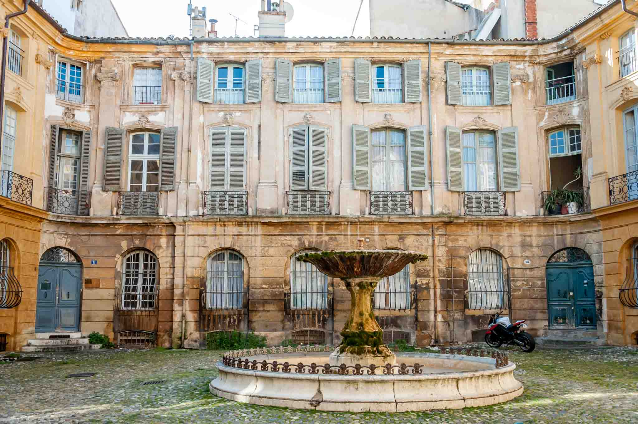 Fountain in a courtyard surrounded by buildings in Aix-en-Provence France