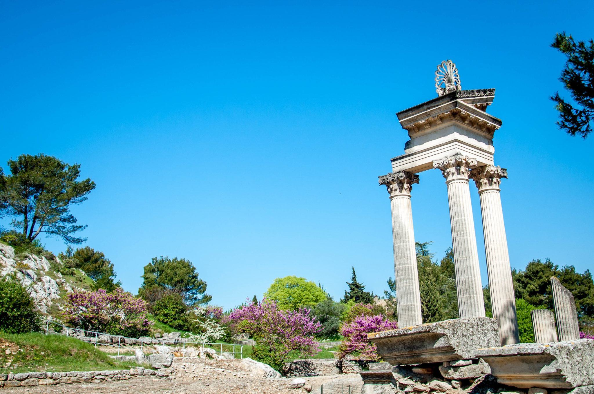 Three columns of a ruined Roman temple at Glanum