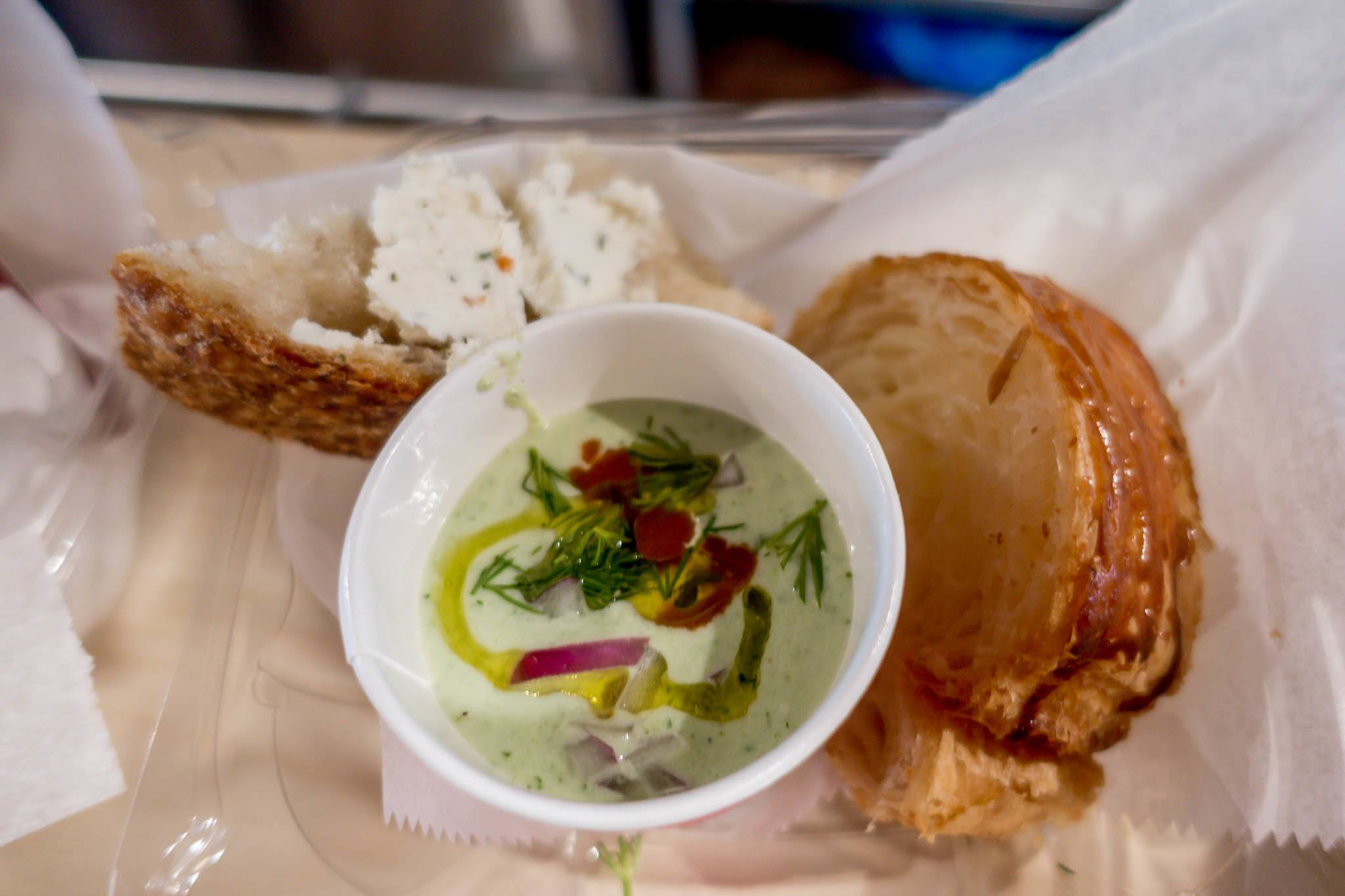 Cup of cucumber soup and bread