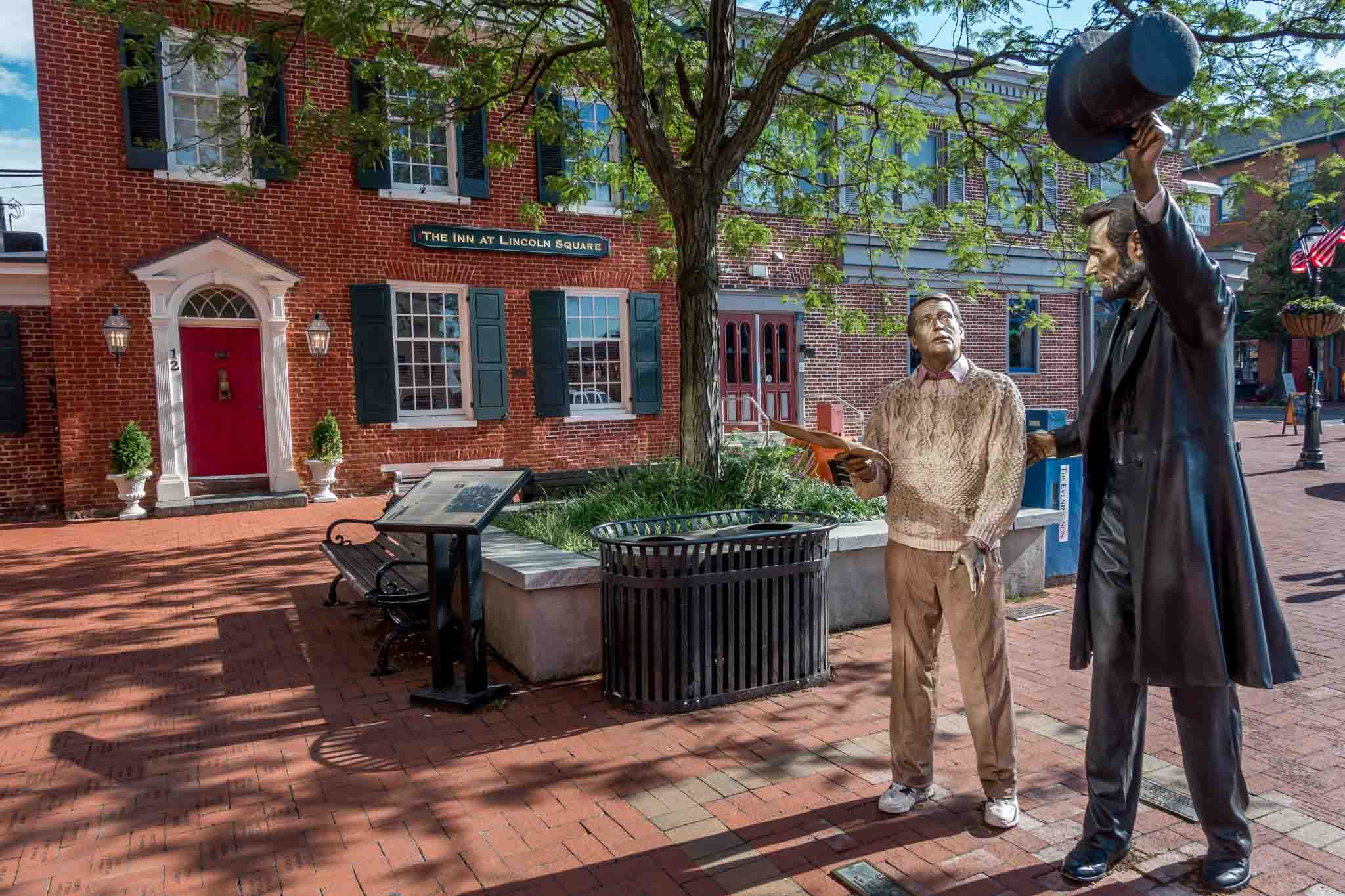 Statue of President Lincoln and a visitor to Gettysburg