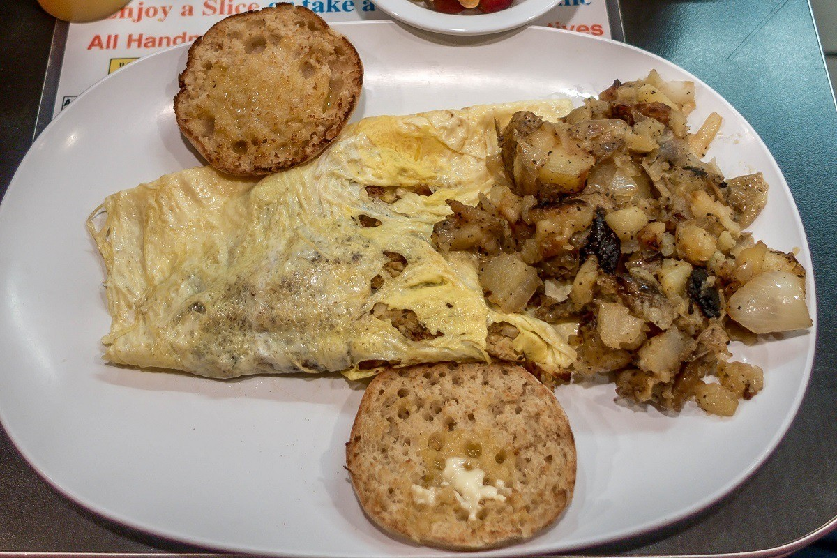 Crab and cheese omelet with potatoes and English muffin