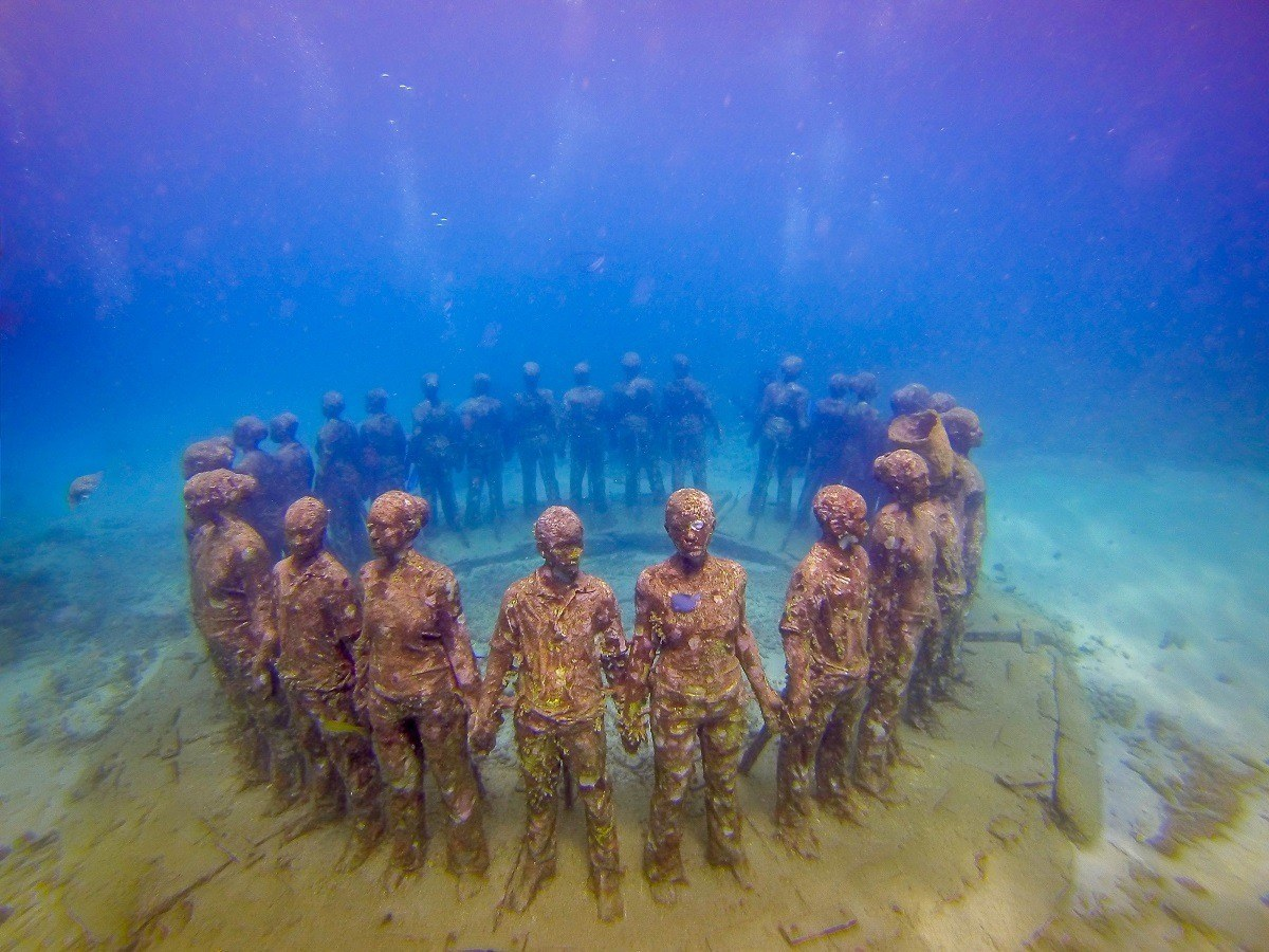 Underwater sculptures of people in a circle off the coast of Grenada