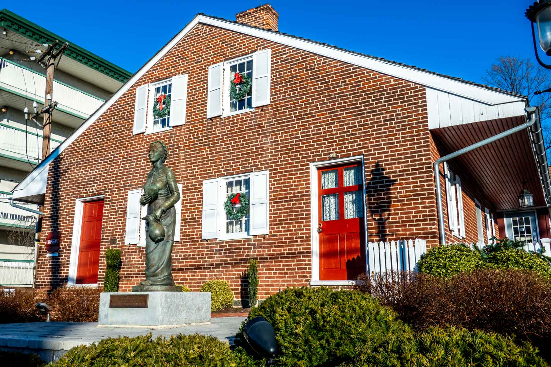 Red brick house with a statue of a woman in front--Jennie Wade, the only civilan killed during the Battle of Gettysburg