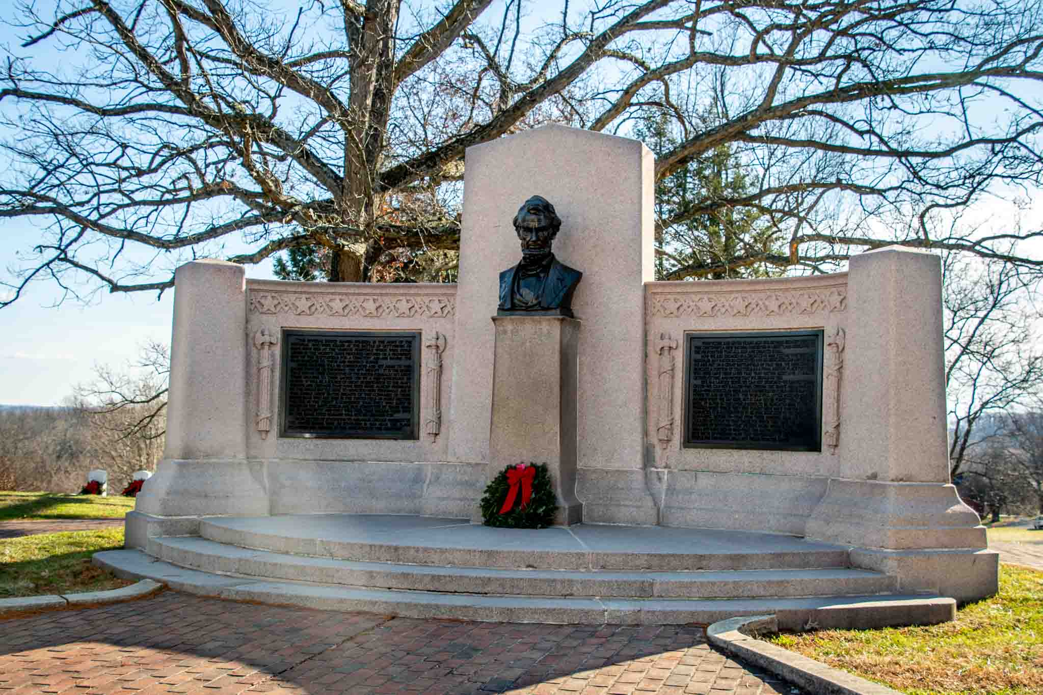 Stone memorial featuring a bust of President Abraham Lincoln commemmorates the site of the Gettysburg Address at the Gettysburg National Military Park
