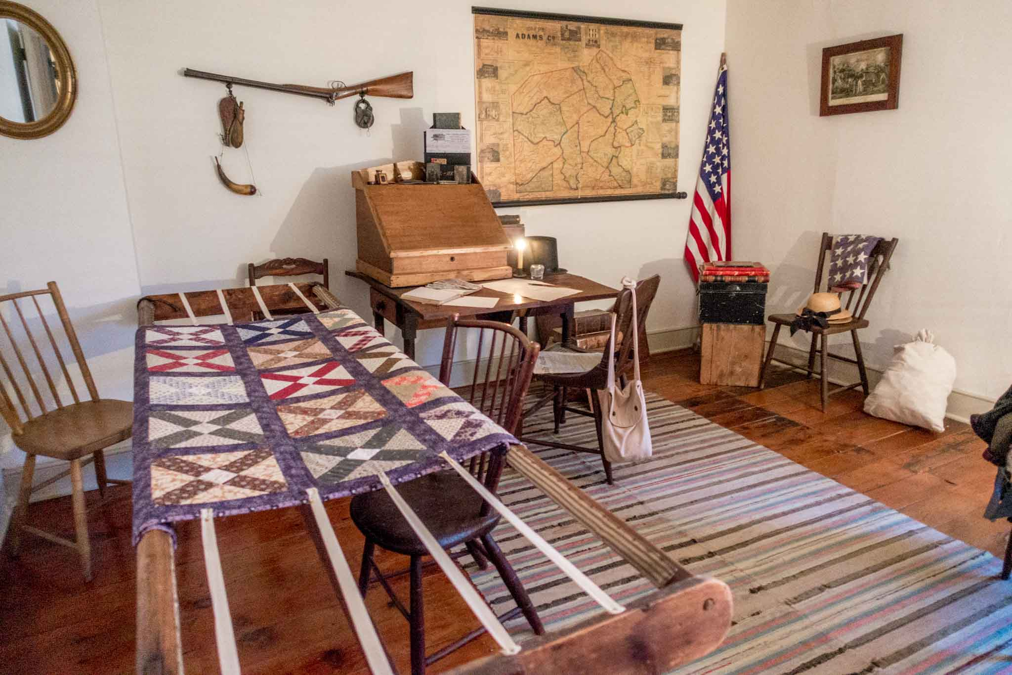 Civil War-era quilting room with desk and map at the Shriver House Museum