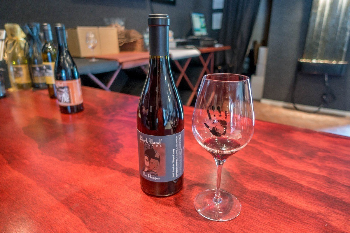 Bottle and glass of wine at Black Hand Cellars