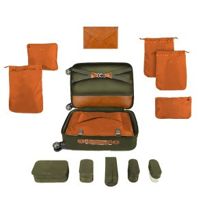 The Ebby Rane Quartermaster Suitcase with storage compartments.