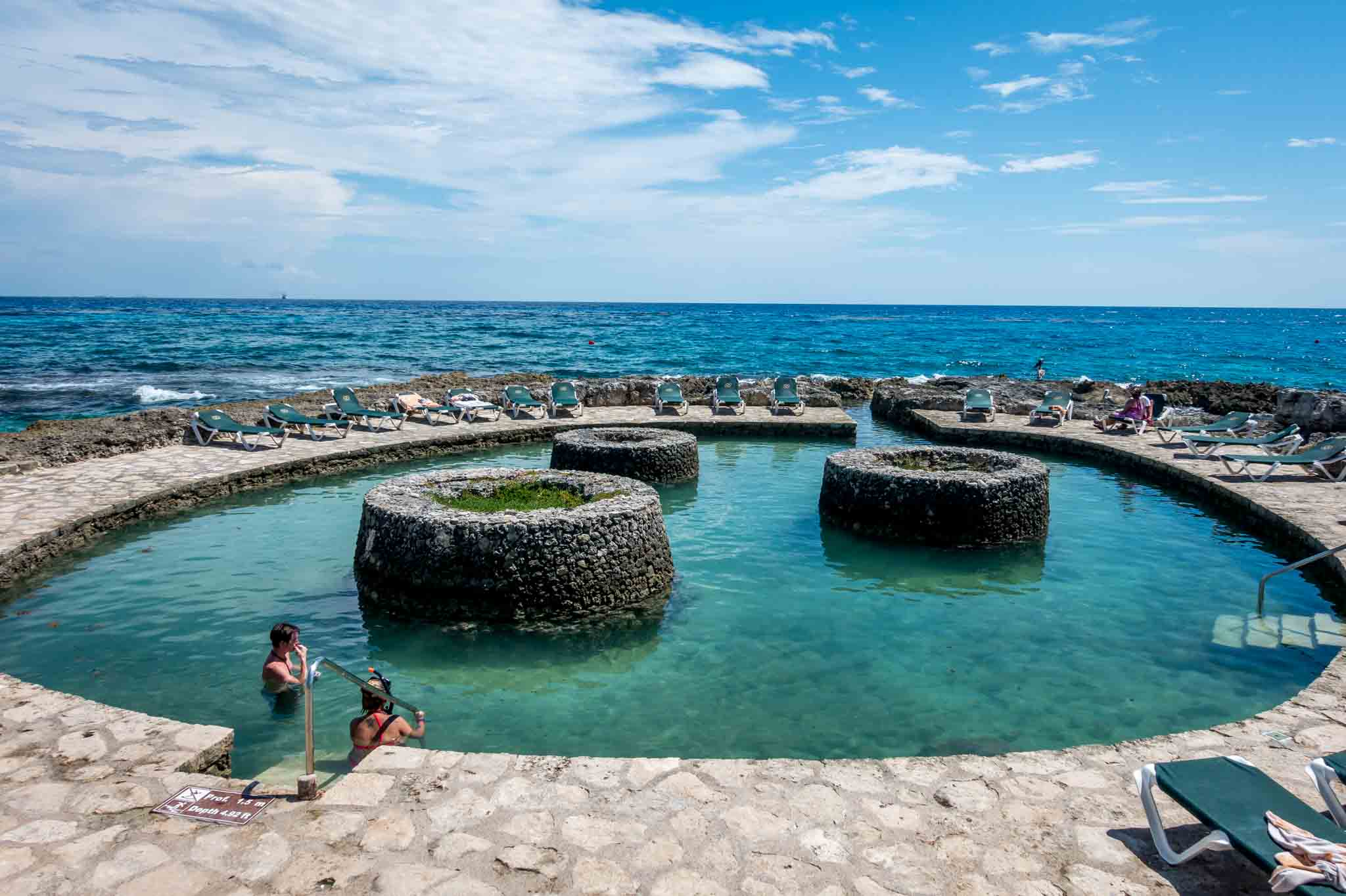 Circular adults-only pool with path to the ocean