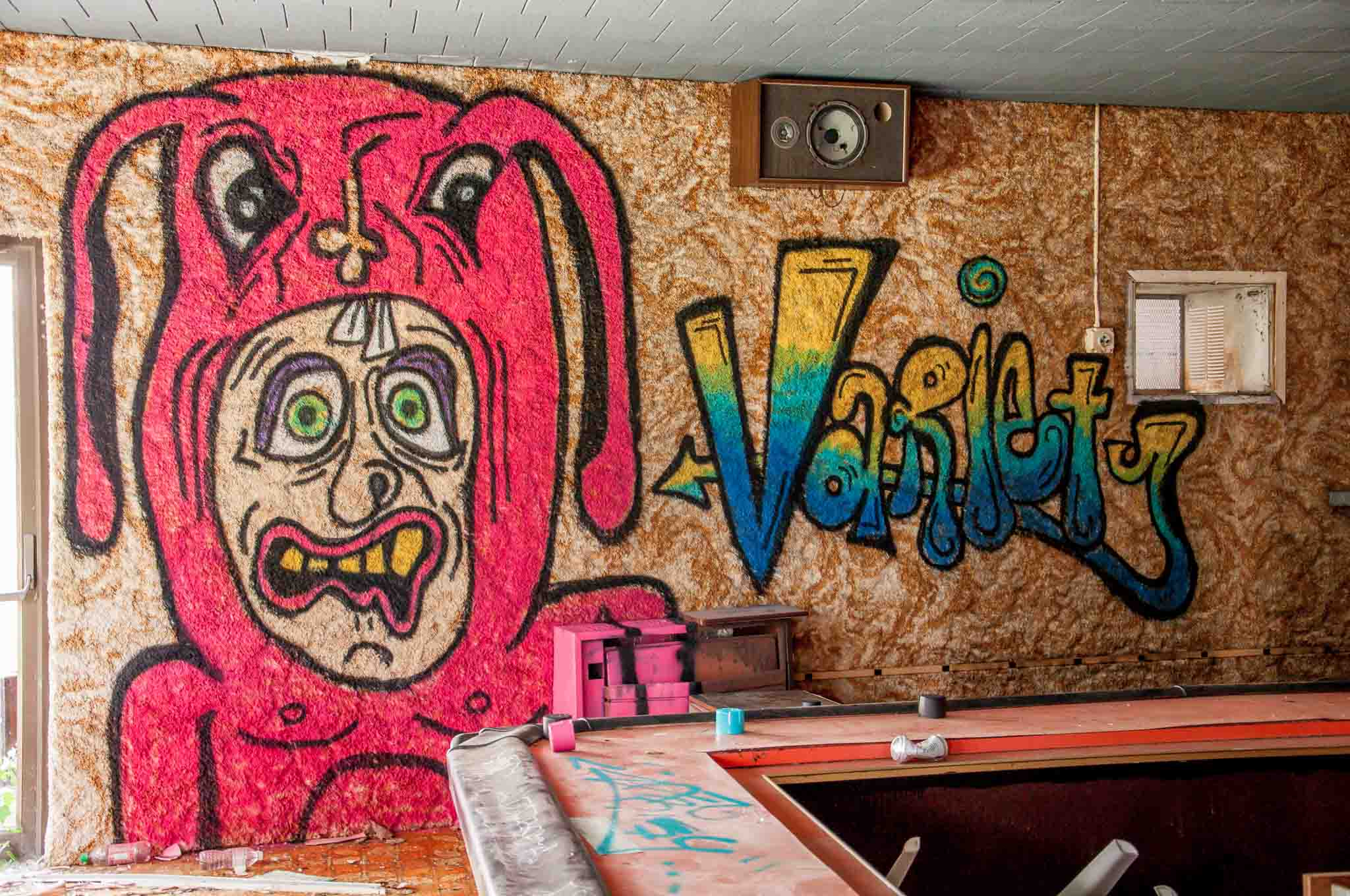 Graffiti at one of the abandoned Poconos resorts. This was once one of the Poconos honeymoon suites hotels.