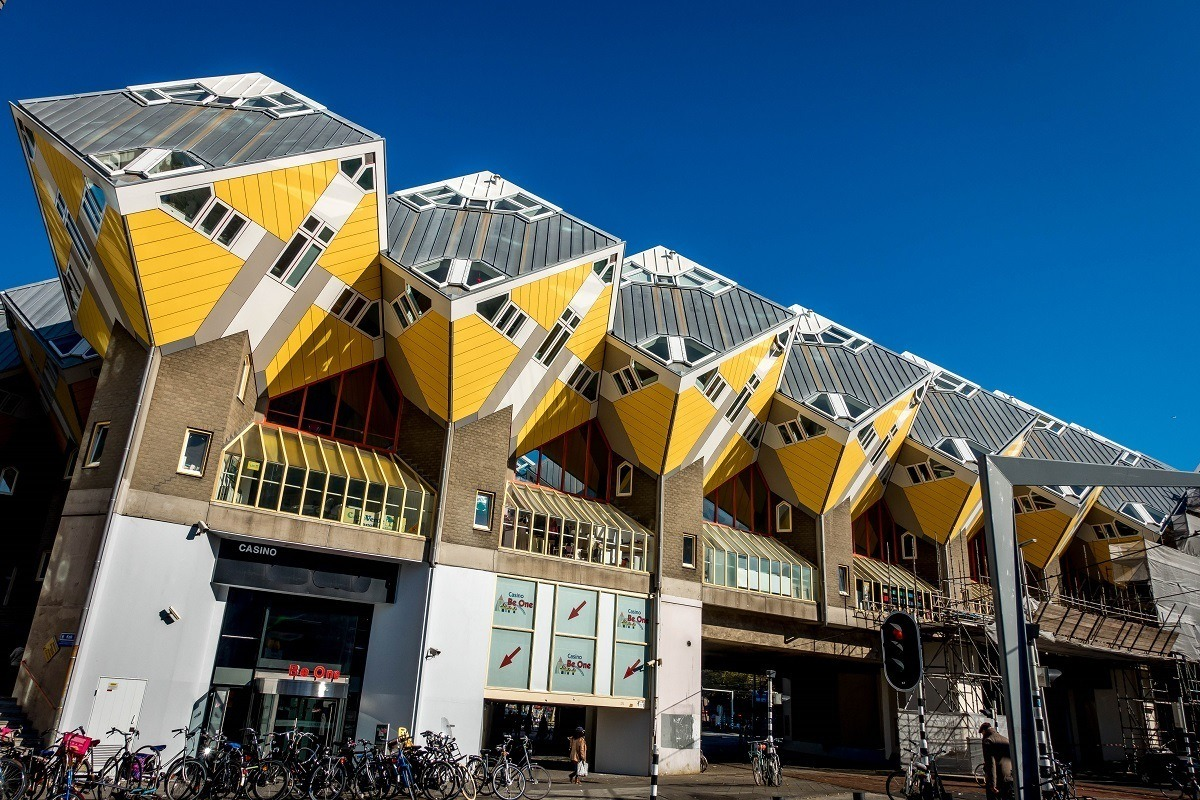 Row of yellow Cube Houses built on a 55-degree angle, unique Rotterdam architecture