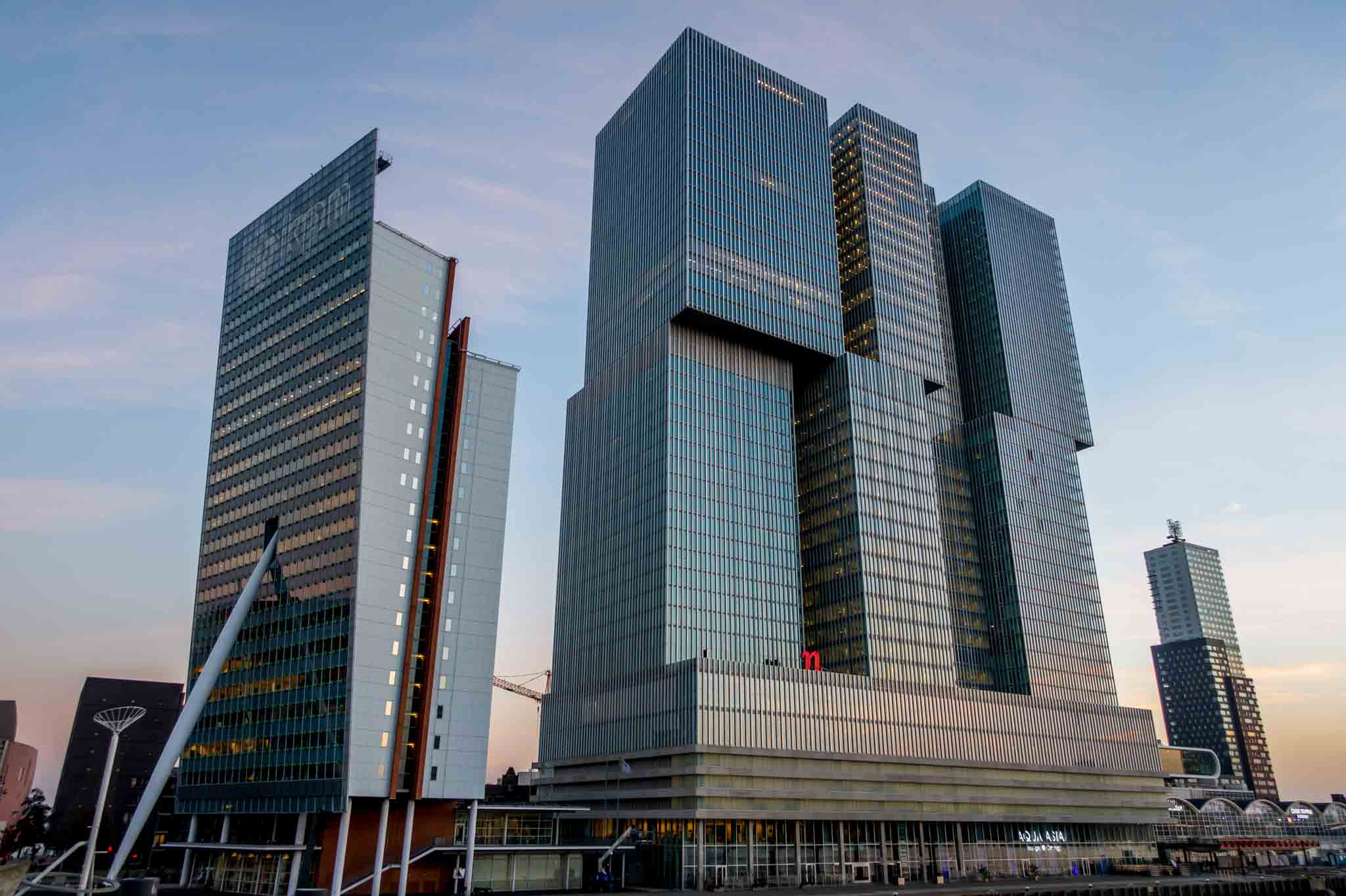 The tangled, gray towers of the De Rotterdam building in Rotterdam