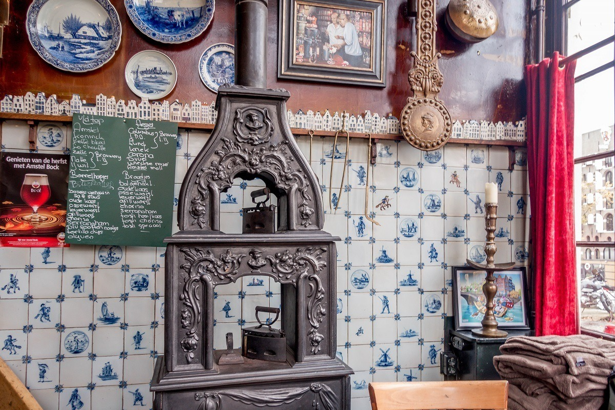 Menu and old-fashioned stove inside one of Amsterdam's brown cafes