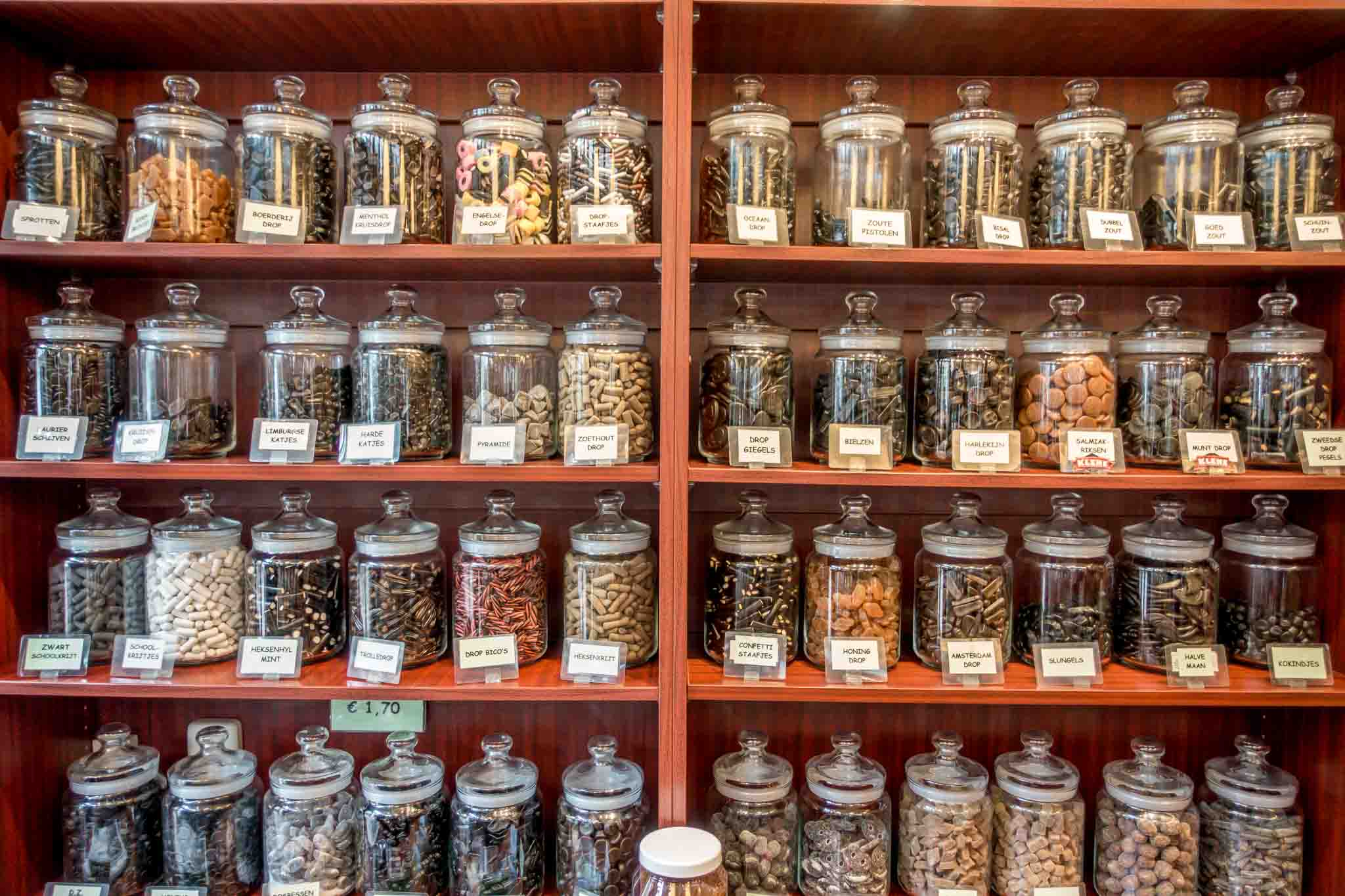 Many kinds of licorice (drop) in jars. Drop is such a popular Netherlands traditional food that the Dutch consume an average of 4 pounds per person each year.