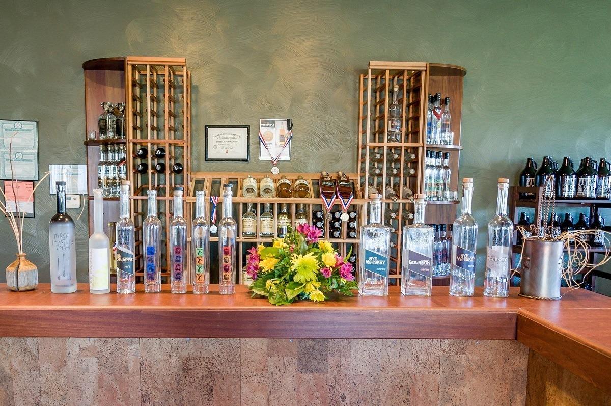 Spirits and wine bottles on display at a tasting bar