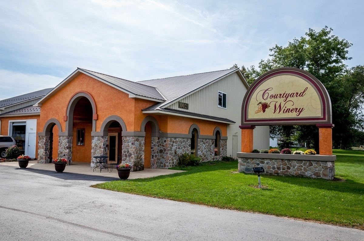 Exterior and sign for Courtyard Winery