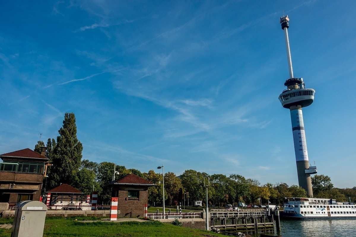 Large, thin Euromast tower with boat at its base