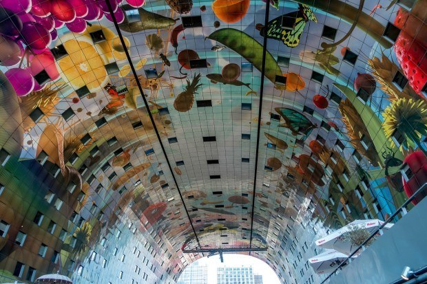 The ceiling of Rotterdam's Markthal is covered in fruits, vegetables, and other items from nature. Rotterdam architecture can be unusual and eclectic, and it's always eye-catching.