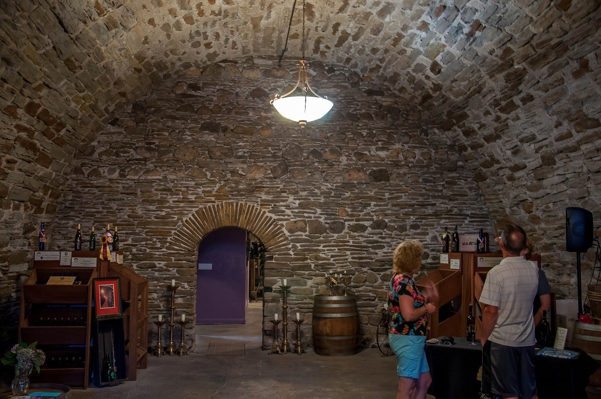 People in stone wine cellar